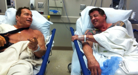 Arnold-Schwarzenegger-and-Sylvester-Stallone-Chill-on-Hospital-Bed