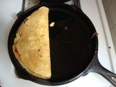 Fold the omelet and let it finish cooking