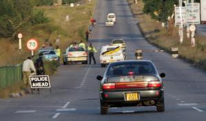 Zimbabwean police inspect motorists at a roadblock near Harare on April 1, 2008. By Alexander Joe (AFP/File)