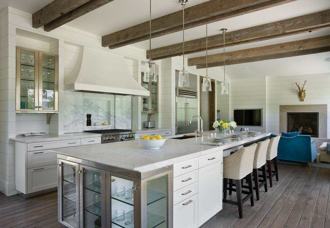 The glass and stainless steel accents give the kitchen a modern flair.