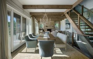 Suited to Haworth's taste, the dining room chandelier adds sparkle to the otherwise neutral colors.