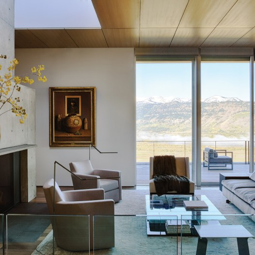 Interior designer Rush Jenkins, co-owner of WRJ Design in Jackson Hole, selected contemporary furniture and accessories in the living room to complement the architecture, including a Grandtorino Sofa from Poltrona Frau, a Mex modular glass table from Cassina, and a rug from Oscar Isberian Rugs.