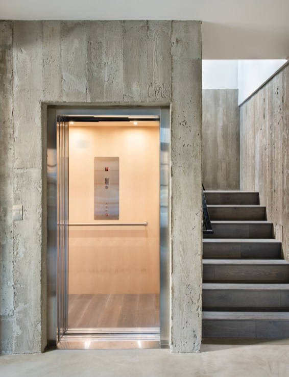 An elevator allows for wheelchair accessibility and also served as the inspiration for the design team to place the main living spaces on the third floor.