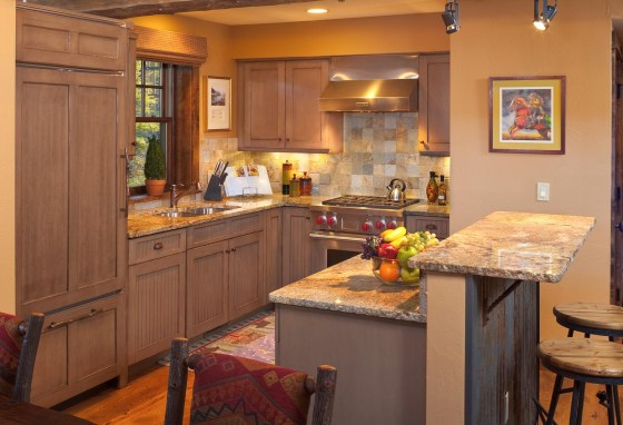 With high-end finishes and the finest appliances, the Robbins' cozy kitchen echoes many Big Sky trophy homes in every way but size.
