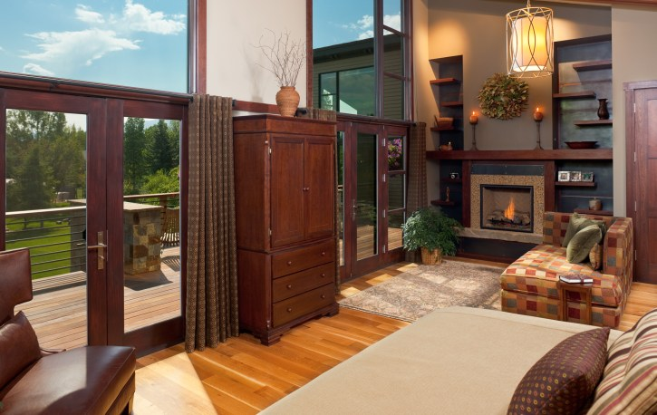 The master bedroom has floor to ceiling windows opening it up to the sprawling backyard.