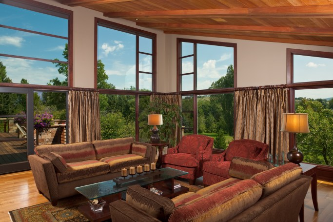 """The great room was designed as """"Rocky Mountain contemporary,"""" elegant enough for gatherings, but comfortable enough for the large family."""