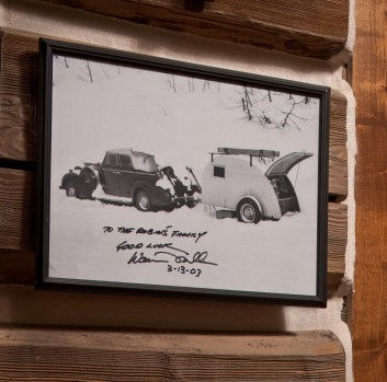 The walls are hung with pictures of skiing lore, including old photos of Warren Miller's early ski film career, and original sketches by Warren Miller and Doug Coombs, addressed to the family.