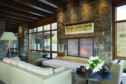 Ceiling beams of 100-year-old reclaimed wood, a Montana stone fireplace and bronze window frames easily reference the valley's mining history while providing a soft modern sophistication.