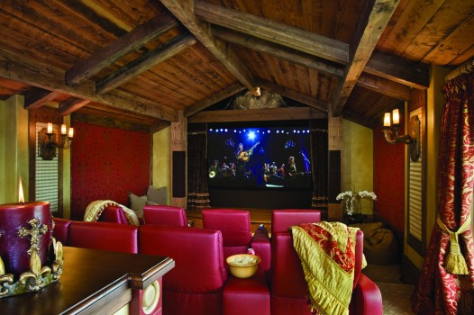 The home theater is a perfect place to relax and enjoy a movie together.