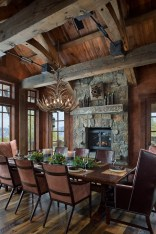 The formal dining room is scaled-down to encourage intimate conversations among guests at the harvest table. Elk horn chandelier by Fish Antlers, rolled leather chairs by Hickory Chair Company.