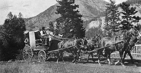 Although stagecoaches were used for tourist rides at the various dude ranches, they were not regularly used in the canyon. Here, Pete Karst takes visitors for a ride at the Karst Kamp. Photo courtesy Arcadia Publishing (Pioneer Museum in Bozeman, MT)