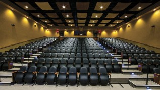 The theater of the Warren Miller Performing Arts Center features 280 seats and acoustic pillow clouds on the ceiling that dampen sound.