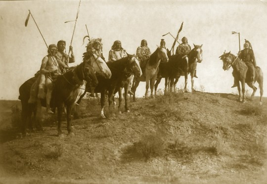 Watching for the Signal, photo by Edward Curtis, c.1908. Description by Edward S. Curtis: When there were indications that the war-party was near the enemy, a halt was made while the scouts reconnoitered the position of the hostile party.