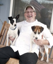 John Winders, owner and chef at Izaak's Restaurant, lives directly behind the restaurant which enables him to run home and check on his dogs between shifts.