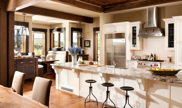 Eschewing the typical dark wood kitchens found in many Montana vacation homes, the designers chose light colors and tile, reminiscent of an East Coast cottage.