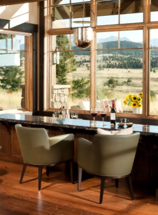 A sunken bar affords guests a 180-degree view of the Pintler Range, as well as the Tom Doak-designed golf course.