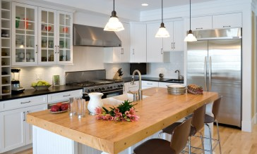 "Outfitted with custom cabinetry by Bozeman Kitchen and Bath, a six-burner, double oven Five-Star gas range, a 48"" x 48"" wide stainless refrigerator and central butcher block island, this kitchen is all about function."