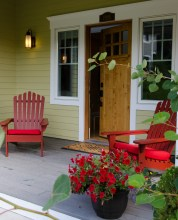 A splash of red is a nice accent in these adirondack chairs.