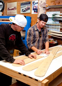 TJ Sneva, left, and Zak Anderson, right, discuss design and specs on the Montana Ski Company ski templates before starting production.