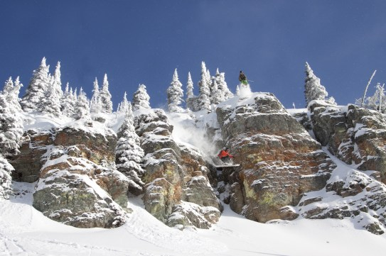 Montana Ski Company team rider Billy Marcial flies over Zak Anderson as the two air out the first ever double huck off Buckle Your Boots, a huge cliff found in bounds at Whitefish Mountain Resort in Whitefish, Mont. Marcial and Anderson are both skiing on Montana Ski Company skis in this cliff jump.