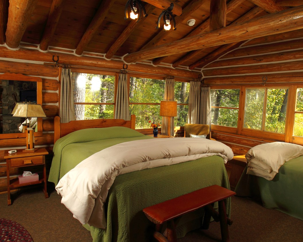 Eleven cabins on the ranch have their own unique charm and a cozy fireplace to boot. Photo by Kenton Rowe