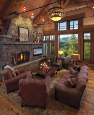 The great room offers a cozy retreat that is still large enough to accomodate the entire family. With an enormous wood-burning Montana moss rock fireplace with massive single slabs of Frontier Stone for the mantel and hearth. The fireplace also includes h