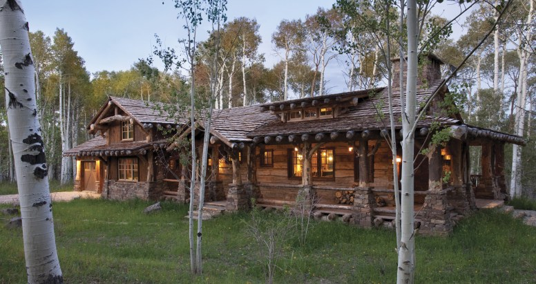 Pearson Design Group and Magleby Construction define pure western elegance in the Utah wilderness retreat. The use of a hand hewn slabs and rafter stock siding made for a truly authentic old-stack cabin look while conventional framing allows for all desired modern amentites