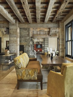 Bozeman based Highline Partners sourced antique hand hewn beach timbers from MRL for the horizontally stacked columns. MRL's hand hewn timber also created the ceiling grid above the dining table, while aged corral board lines the living room's vaulted