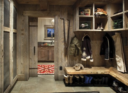 Another contemporary look merging antique materials with modern functionality, from the mud room's corral board paneling to its sturdy, hand hewn slab benches. Faure Halvorsen Architects with Highline Partners.