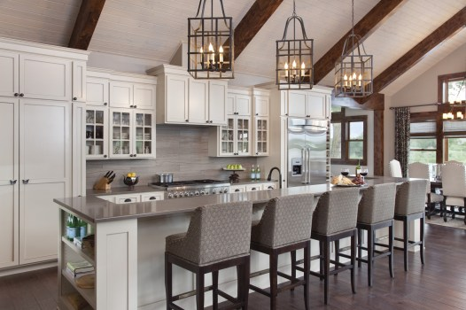 The kitchen's design was a collaborative effort between Steve Farnam and Heather Harkovich. In the kitchen, custom cabinets — made of painted maple and designed by Steve Farnam — Caesarstone counter tops, a custom copper sink and a 16-foot bar provi