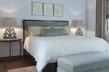 """Neutral tones remained common throughout the home, with subtle offsets of color as seen here in the blue room. Homeowner Judy Blue desired a warm and inviting look that said """"Welcome."""""""