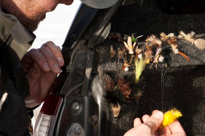 The bed of Straub's pickup is lined with carpet, which handily holds a selection of flies.