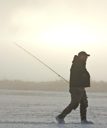 Pat Straub heads back to the car through a hazy afternoon after fishing the East Gallatin on the Milesnick Ranch north of Belgrade