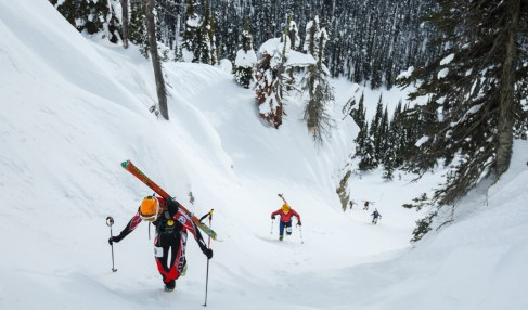 Racing up the steepest terrain, skimo athletes roll up the skins, shoulder their skis and continue to bootpack up the mountain during the Whitefish Whiteout. Photo by: Noah Clayton