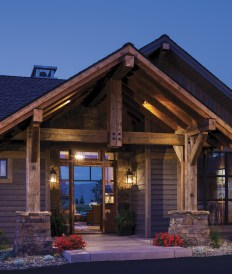 The home's exterior was designed to blend into the surrounding landscape with neutral colors and timber and stone.