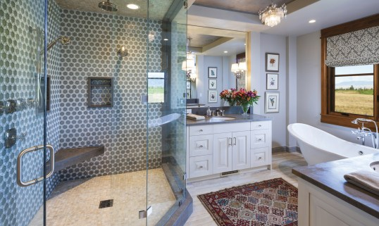 Eschewing rustic all together, in the master bath, the geometrical tile, glass and crisp finishes create a modern elegance.