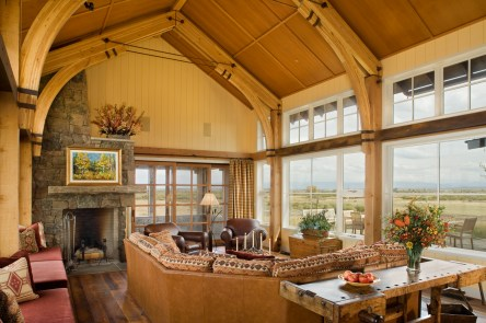 The colorful walls and arching ceiling in the great room pay tribute to JJ's Eastern roots. In contrast to the rustic nature of the surrounding ranch buildings Carney Logan Burke designed a refined interior with contemporary brightness.