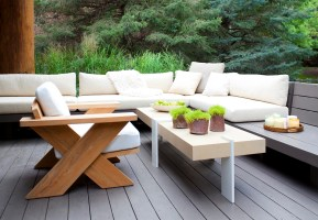 The transition from the living, dining and kitchen area to the exterior deck is seamless as the interior palette echoes the natural surroundings. Custom furnishing designed by Berman/Rosetti.