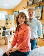 Artists Michael and Meagan, of Blessing Fine Art, work in their studio in Bridger Canyon, north of Bozeman, in June. The husband and wife artists are known for their western contemporary paintings.