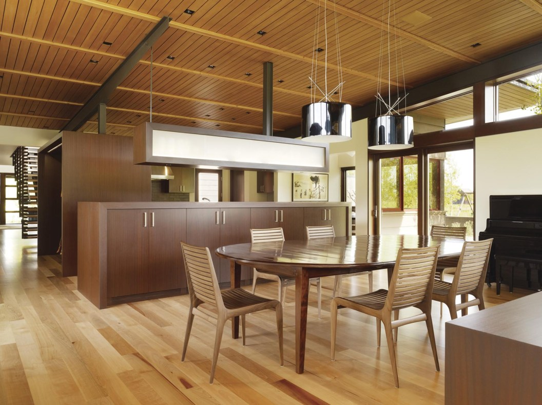 In the Peaks View dining room and kitchen Sapele cabinetry separates the spaces. FSC Certified Madrone floors, hemlock ceilings and steel detailing add warmth and texture in the primary living space.