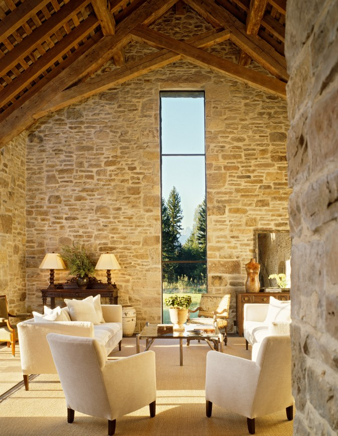 """Exposed timbers and parged stone walls nearly outdo the view of The """"Grand"""" which is oriented in the center of the window. Reconstructed from the late 1800's, the window proportions were enhanced slightly but are derived from the original creamery d"""