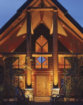 Echoing the surrounding forest, Orlan Sorenson applied exaggerated height to this timberframe and log home.