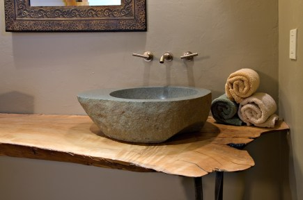 A custom made stone vessel sink is just one of the many details that makes this residence unique.