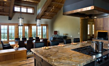 The kitchen affords views of both the dinning area as well as the entryway, with windows upon windows installed carefully throughout. Natural lighting plays an integral part in the house.