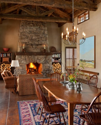 The Gathering Hall is the center of this family camp. Reclaimed timbers and Montana stone punctuate the 1,400-square-feet of living space with dining area, kitchen and seating for playing games and cozying up to the fire.