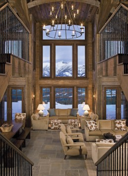 """The two-and-a-half story great room has windows that perfectly frame the Spanish Peaks. """"The house is oriented so that as you walk in, it's centered on one of the Spanish Peaks,"""" explains lead architect Vince Falotico. """"The whole house is very sym"""