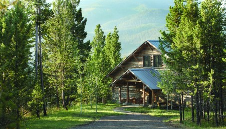 Tucked into the trees and off the grid, the Moose Creek cabin is made of traditional round logs, stone and reclaimed wood, while being decidedly nontraditional by using solar and geothermal energy sources.
