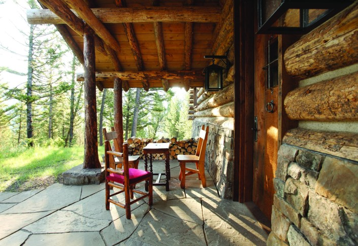 Miller Architects integrated form and texture within the traditional cabin materials, incorporating indigenous round logs, Montana stone and reclaimed wood both outside and in.