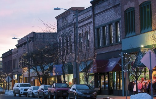 Colorful First Avenue alive with winter carnival flair in Sandpoint, Idaho.