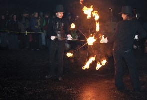 Merrymaking and mysterious fun, bio-luminesces fire dancers entertain the crowds with their red hot performance.